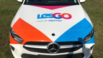 Autoreclame detail verkeersschool lesgo Mercedes