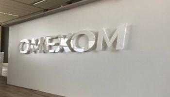 indoor sigining logo Omexom - Van Dijk Signmakers